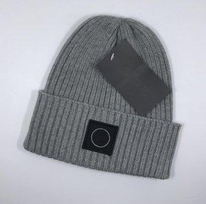Sonbahar Moda örgü kış sıcak şapka kadın ve erkek şapka rüzgar Örme kap Yün şapka 5colors Örgü şapkalar siyah beyaz mavi ücretsiz gönderim UCUZ