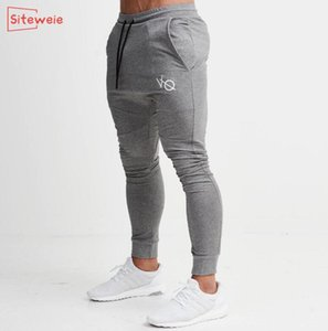 SITEWEIE Cotton Jogger Workout Trousers Outdoor Cotton Track Pant Sportswear Fitness Pants Men Gyms Skinny Sweatpants G244 201004