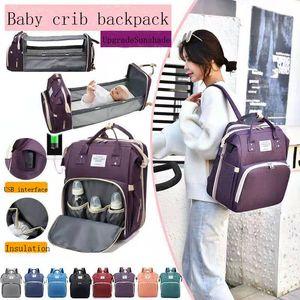 Neueste tragbare Faltkrippe Wickelbeutel USB Reiserucksack Mode Handtasche Babypflegebett Klappbett Windel Tasche Multi-Funktion Mutter's Tasche