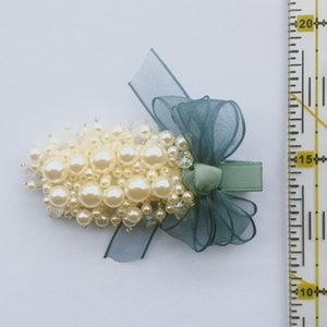 Pearl bow-tie hairpin