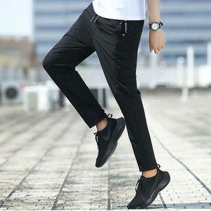 Novas calças masculinas casuais Moda Streetwear Rápido Seca Respirável Sweatpants Masculino Calças Hip Hop Micro Elastic Force Men Calças