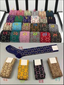 2020 Calcetines de diseñador de mujeres con letra de moda Calcetines a rayas Nuevas Medias Unisex Unisex 1 Parques con caja de regalo Media larga 29 Colores