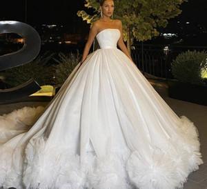 Robes de mariée élégantes 2021 Dernière robe de mariée A-line robe de mariée Robe de mariée balayer Train Ivoire Tulle Ploits Volants Jupes à niveau