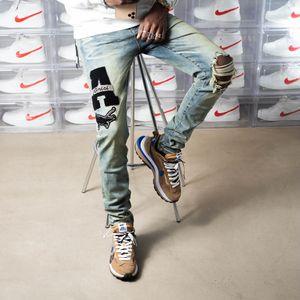 Neue Ankunft Herren Designer Jeans Strass Patch Medaille Fold Mode Herren Jeans Slim Motorrad Biker Hip Hop Pants Top Qualitätssize 28-40