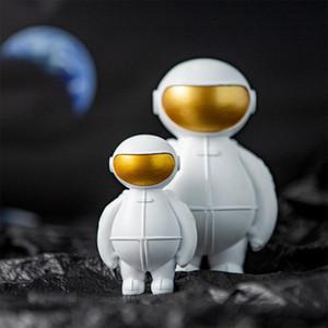 Nordic Ins Résine Creative Astronaut Sculpture Artisanat Figurine Magasin bureau Décoration Accessoires moderne Cartoon cadeau d'anniversaire