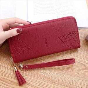Wallet female 2020 new Korean version of the print hollow metal ladies clutch bag large capacity floral zipper long