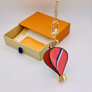 Portachiavi del designer della mongolfiera dell'aria calda con la scatola e la borsa della polvere Donne delle donne 2021 moda carino borsa auto borse a catena portachiavi anelli a catena fatti a mano Keychains fibbia