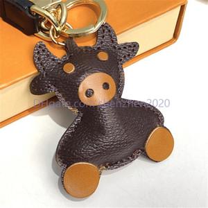 Nuevo Diseñador Ox Ganado Vaca Llavero Llavero Anillos Moda Hombres Coche Llavero Titular Mujer Bull Ox Colgante Navidad Año Nuevo Regalo con caja