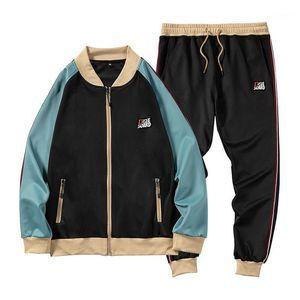 Patchwork Stripe Tuecksuit Uomini Due pezzi Abbigliamento Set di abbigliamento Casual Felpa con cappuccio + Pantaloni Traccia Abito da uomo Sportswear Swearsuits Sports Wear1