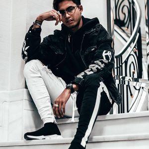 Mens bicicleter jeans primavera joelho buracos rasgados preto branco patchwork jean calças elegantes streetwear para homens