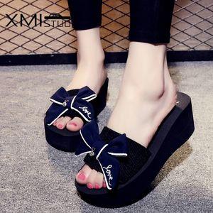 Xmistuo Yaz kadın Takozlar Sandalet Terlik Yay Slaytları ile 7.2 cm Yüksek Topuklu Plaj Kadın Terlik 4 Renk 7140 W Y200624