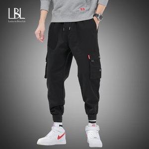 Новые Мужчины Брюки Хип-хоп Гарем бегуны Брюки Новые Мужские Брюки мужские бегуны Solid Multi-карманные брюки Sweatpants M-8XL 201111