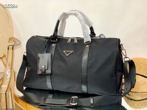 Neue klassische Reisetasche Handtasche Segeltuch wasserdicht super große Kapazität Schulter Stoff Paar Prahlerei Tragbares Schwarz