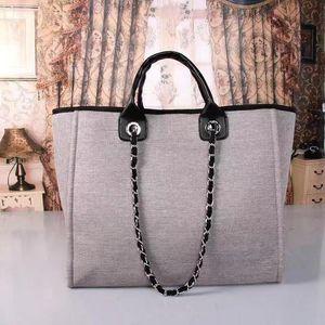 Классический дизайнер бренда Новая мода Женщины Большой емкости Холст сумка, Бренд Дизайнерская сумка на плечо. Бесплатная доставка, мешок с горячей цепью