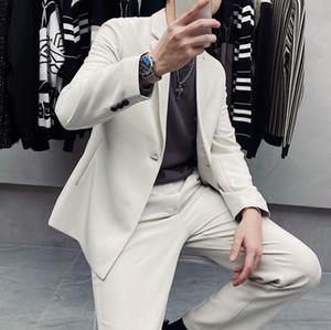 2020 otoño y del invierno Nueva Juventud populares de los hombres de Corea suelta Sólido Botón solo color Suit + pantalones rectos simples Traje
