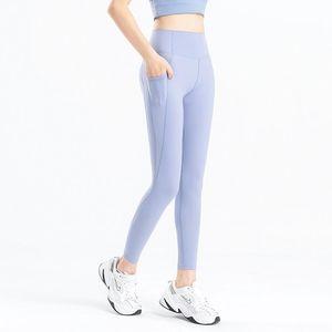 2021 Side Side Pantalones de yoga medias Ejercicio Mat Matte desnuda mujeres Yoga Peach Sheer Joggers Pocket Hip Yoga Mujer Fitness Sexy Pants Pantalones BTTUX
