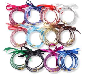 Venta al por mayor 5pcs / set Todo el tiempo Glitter Bangles Set Glitter lleno de silicona Plástico Bowknot Jelly Summer Bracelets Hot Selling PS2253