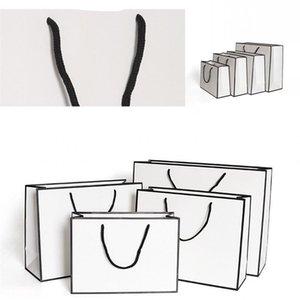 DHL Ship Kraft Paper Thicken Bags White Card Packaging Bag Advertising Fashion Storage Handbag Shopping Party Customized Clothing 1