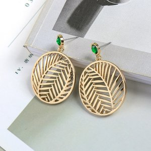 Creative hollow leaves round geometric fashion alloy Earrings stud European and American style holiday party for women