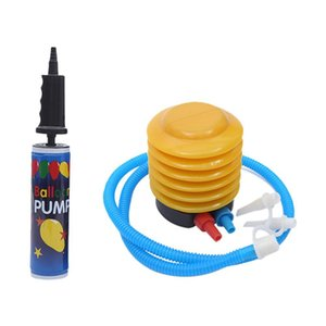 A portable air pump outside the foot balloon inflates a tool held in the hand of a swimming pool charging pump for swimming rings.