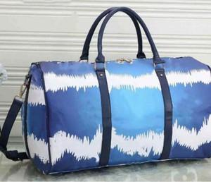 2020 women men bags new fashion men women travel bag duffle bag, leather luggage handbags large capacity sport 55cm bag