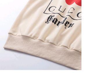 Frauen Sweatshirts Mans Frauen Langarmshirts Pullover Herbst Frühling Kleidung Schwarz weiß gedruckte Buchstaben Ananas Daisy Kleid