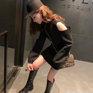 Atractivo del hombro vestido de punto de manga larga para las mujeres Negro otoño e invierno nueva pequeña discoteca A1107 estudiante falda con fondo