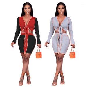 Сексуальный стиль 2 частей наборы женские наряды сплошной цвет лоскутное галстука лук с длинными рукавами Урожайные вершины Bodycon юбка костюма одежда1