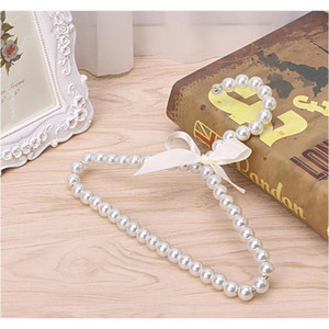 wholesale 10 pcs fashion plastic pearl beaded bow baby clothes hangers storage dry rack shipping