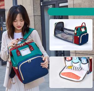 Multifunzione Viaggi Diaper Bag Mamma zaino portatile Culla Kid Carry Cot USB Charge grande base di bambino di maternità della borsa Passeggino