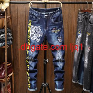Autumn and winter new men's jeans tiger head embroidery printing blue slim hole pants fashion