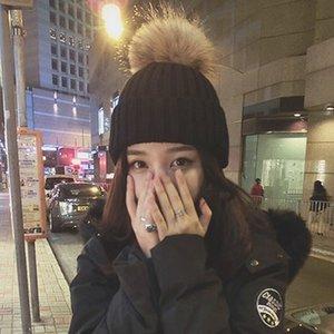 A2 Nuovo Imitazione coreana Imitazione Purcoon Dog Pur Ball Ball Wool Donne per bambini addensato erba inverno genitore-bambino cappello a maglia