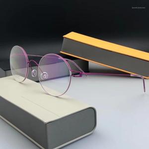 2020 Gafas de titanio Marco Men Ultralight Redondo Myopia Eyeaglass Prescription EyeGlasses Marco Mujer Púrpura Gold Eyewear1