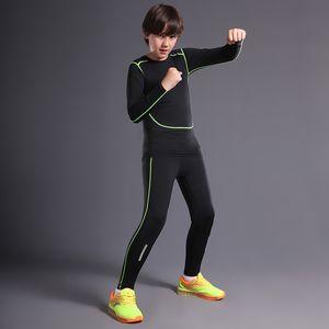 Compressione degli uomini che esegue il calcio dei bambini del calcio del calcio Biancheria intima del pallone da basket del calcio Abito da jogging del fitness