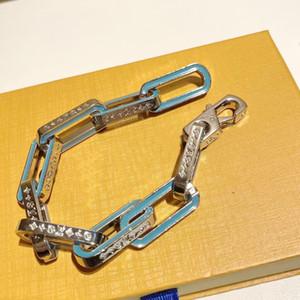 2021 Europa America Uomini Argento-Color Metal-Color Inciso V Iniziali Fiore Blue Smalto Collegamenti Catena Collana Braccialetto Bracciale Set di gioielli