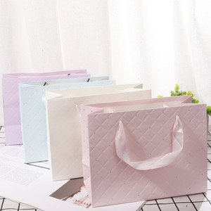 light embossed four color white card handbag simple gift bag clothing shopping bag paper bag can be customized Cross border foreign trade