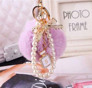 2020 Fashion Pearl Chain Crystal Bottle Bow Pompom Keychain Car Women Handbag Key Chain Ring Fluffy Puff Ball bbyaVW nana_shop