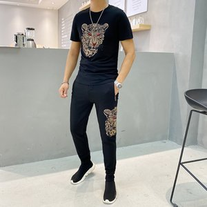Spring and summer new men's high quality hot drilling sports suit fashion short sleeve+pants fashion sportswear suit 1004