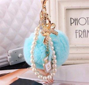 2020 Fashion Pearl Chain Crystal Bottle Bow Pompom Keychain Car Women Handbag Key Chain Ring Fluffy Puff Ball bbyqDf bde_home