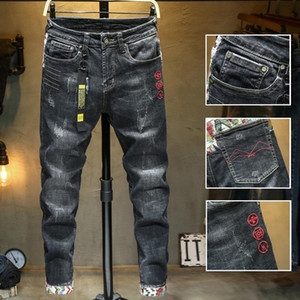 863 men's elastic jeans with embroidered holes
