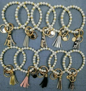 European and American Creative Fashion Pearl Bracelet Ring Keychain Leopard Print Pure Color PU Leather Tassel
