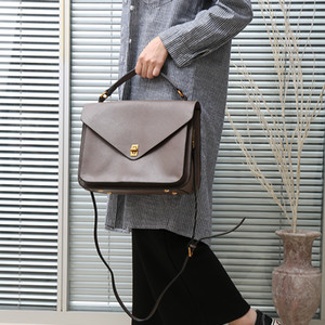 Charm2019 Time Leisure Portable Genuine Leather Woman Cowhide Postman Briefcase Ol Commute Single Shoulder Span Package