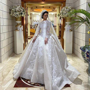Luxury Modest Ball Gown Wedding Dresses Jewel Neck Lace Appliqued Long Sleeves Wedding Gowns Saudi Arabian Dubai Bridal Dress