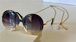 New fashion design sunglasses 170 round frameless lens metal hollow frame with adjustable chain modern pop style uv400 protective glasses