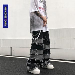 UNCLEDONJM Tassel Pants Men's Fashion Brand Ins Pendant Wide Leg Hip Hop Lazy Wind Jeans Couple's Pants Loose jeans men N06 201004