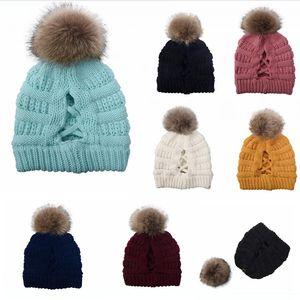 Les femmes Pompon Bonnet Criss Cross Ponytail Hat chauffent Ski Cap d'hiver doux tricot Messy Bun Beanie DDA631-2