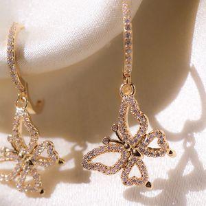 جديد رومانسي روز لون الذهب فراشة سيدات إسقاط أقراط مطعمة كريستال الزركون أنثى القرط الأزياء والمجوهرات