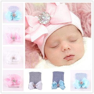 INS Newborn Hats Winter Knit Hat with Big Bowknot Shiny Crystal Stone Striped Knitting Hats Infant Baby Cute Soft Beanies Skull Caps LY1030