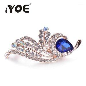 Iyoe Fashion Feather Broches Pines para mujer Joyería Big Crystal Rhinestone Flower Broche Femenino Vestido elegante Regalo de boda1