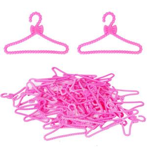 20 PC / rosa ropa de color Perchas Bowknot del diseño del vestido de los niños de juguete de regalo 1/6 ropa Accesorios para la muñeca Barbie Perchas de las niñas